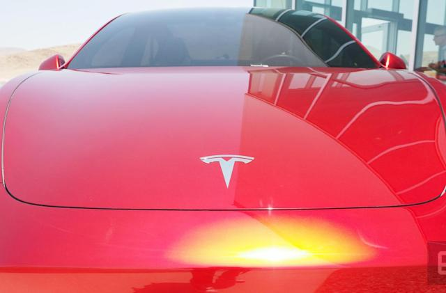 Tesla posts its first profit in two years