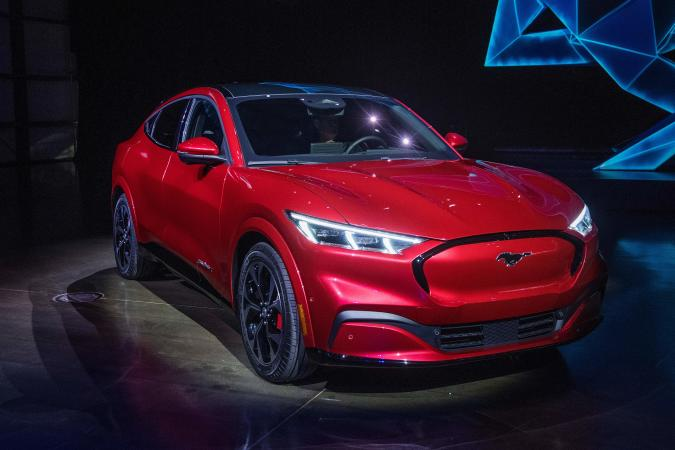 Ford reveals its first mass-market electric car the Mustang Mach-E, which is an all-electric vehicle that bears the name of the companys iconic muscle car at a ceremony in Hawthorne, California on November 17, 2019. - This is Ford's first serious attempt at making a long-range EV and will be the flagship of a new lineup that will include an electric F-150 pickup truck. (Photo by Mark RALSTON / AFP) (Photo by MARK RALSTON/AFP via Getty Images)