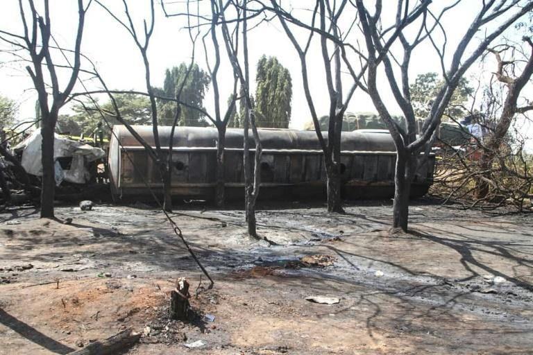 Burnt trees and the carcass of a burnt out fuel tanker is seen along the side of the road following an explosion on August 10, 2019, in Morogoro (AFP Photo/STRINGER)
