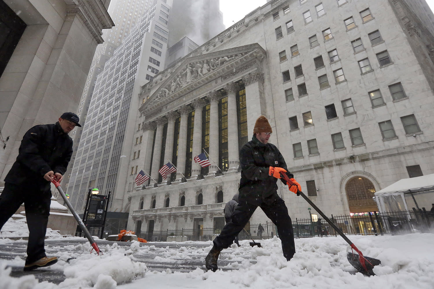 <p>Snow is shoveled from a sidewalk adjacent to the New York Stock Exchange, Tuesday, March 14, 2017. New York Gov. Andrew Cuomo has declared a state of emergency Tuesday for all of New York's 62 counties, including New York City's five boroughs. (Richard Drew/AP) </p>