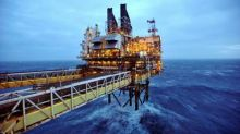 BP to buy back $1.4bn of shares and raises dividend as rising oil price boosts profits