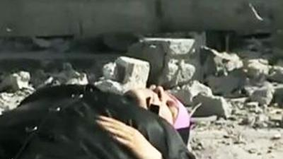 Raw: Syrian Woman Caught in Gun Battle