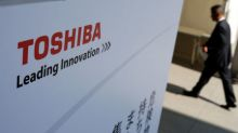 Toshiba gets go-ahead for chip unit sale at angry shareholder meeting