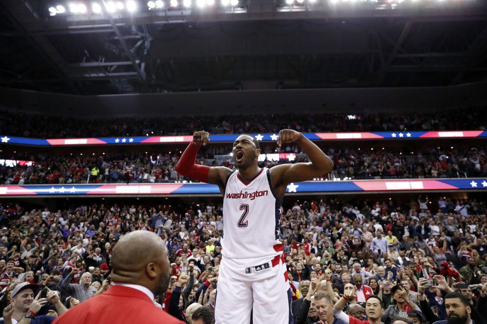 An emotional John Wall roars as he celebrates the Wizards' season-extending Game 6 win. (AP)