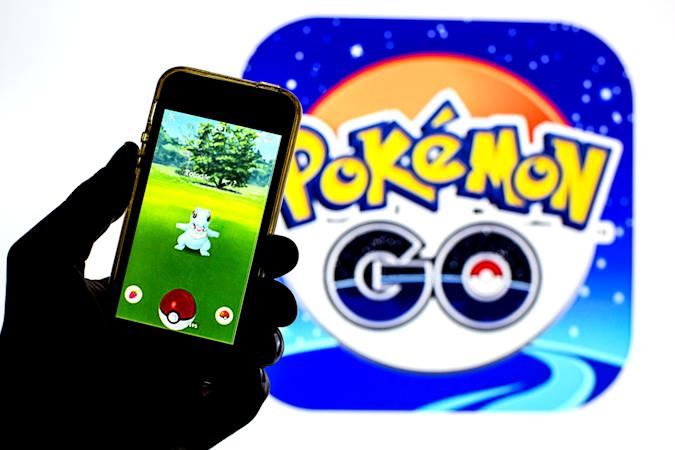 BARCELONA, CATALONIA, SPAIN - 2021/07/26: In this photo illustration a Pokémon GO app seen displayed on a smartphone with a Pokémon GO logo in the background. (Photo Illustration by Thiago Prudêncio/SOPA Images/LightRocket via Getty Images)