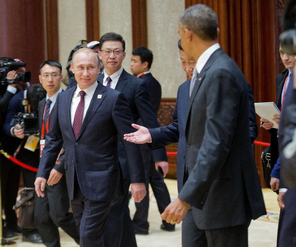 Russian President Vladimir Putin (L) Chinese President Xi Jinping (C) and US President Barack Obama are seen arriving at the the Asia-Pacific Economic Cooperation Summit in 2014 (AFP Photo/Pablo Martinez Monsivais)
