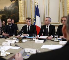 The Latest: Macron promises tax relief for workers, retirees