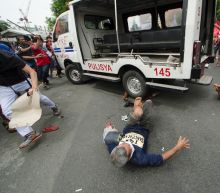 Philippine police van runs over protesters