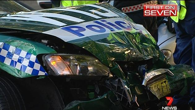 Man injured in police car crash