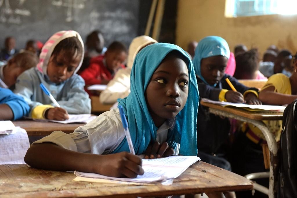 Human Rights Watch says public secondary schools in Senegal charge upwards of 50,000 CFA francs ($93) per student, far too high for many families (AFP Photo/SEYLLOU)