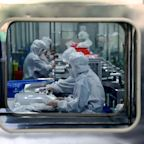 1,700 health workers infected, first fatality in Japan