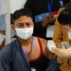 Sanitation worker gets first shot as India launches COVID-19 vaccination campaign