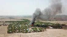 Rights group: Satellite images show Myanmar village burning