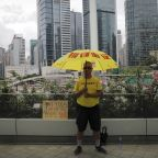 The Latest: Hong Kong leader Lam apologizes but won't resign