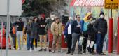 People line up to get into a store in Royal Oak, Mich. (Getty Images)