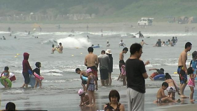 Japanese seek relief from heat at beaches near Fukushima disaster