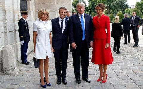 French President Emmanuel Macron, second left, his wife Brigitte, left, pose with U.S President Donald Trump and First Lady Melania Trump at Les Invalides museum in Paris - Credit:  Michel Euler/AP