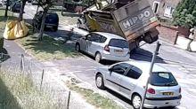 Skip lorry takes a tumble