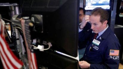 Wall St. down 1% on tech woes, trade war fears