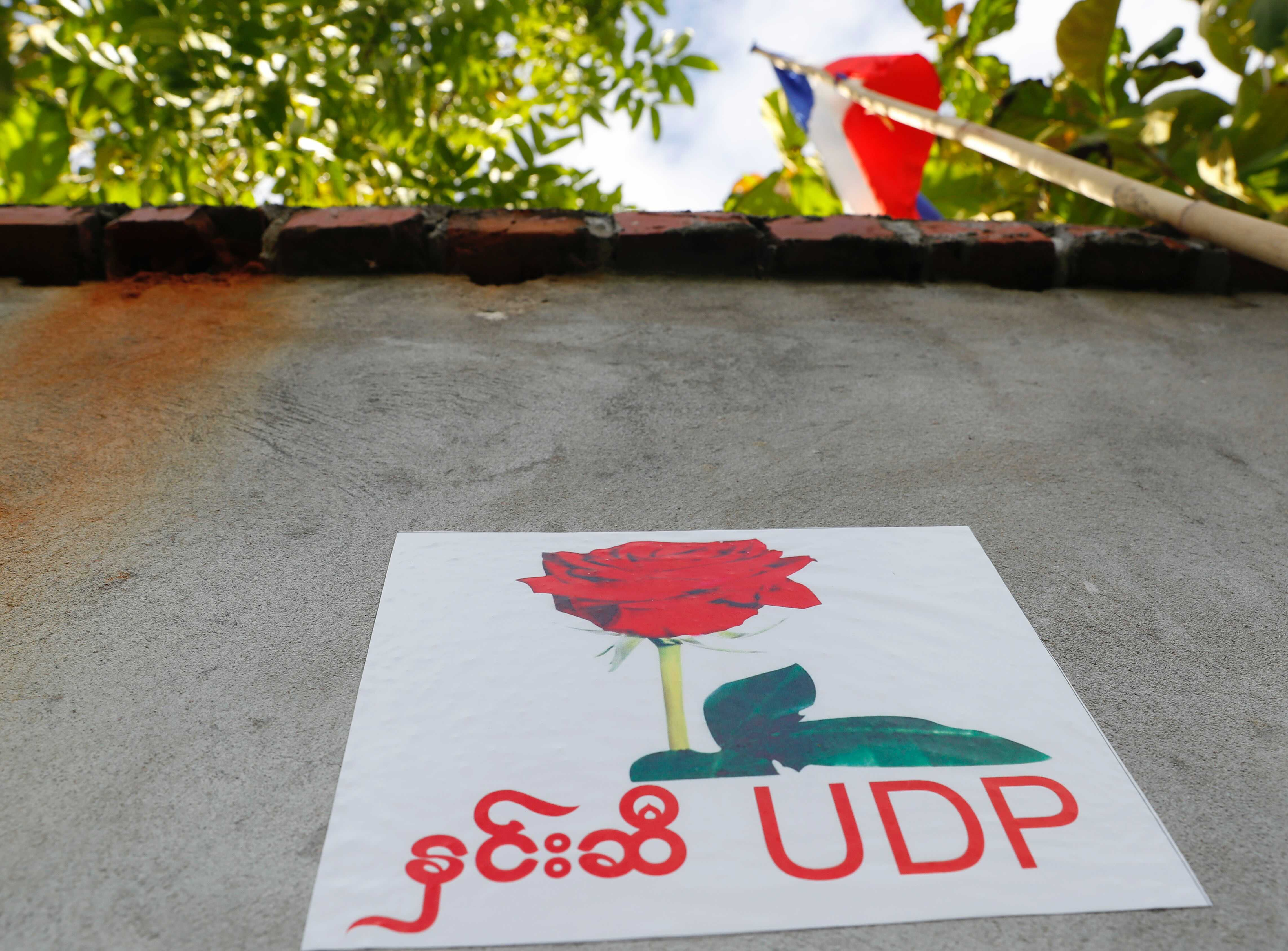 A poster of the United Democratic Party is posted on the wall of the party's headquarters Wednesday, Sept. 30, 2020, in Naypyitaw, Myanmar. Kyaw Myint, the chairman of the United Democratic Party has been arrested as a fugitive from justice after recent reports in Myanmar media contained allegations of a shady past, including financial finagling and a prison escape. The party is fielding the second highest number of candidates for the November elections, and other party executives say it will carry on campaigning. (AP Photo / Aung Shine Oo)