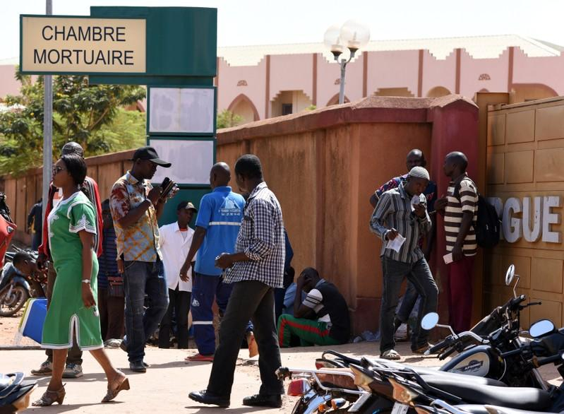Relatives of victims of an attack on a road leading to the Boungou mine, operated by Canadian gold miner Semafo, wait outside a morgue in Ouagadougou