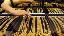 Gold rises on robust demand, global cues