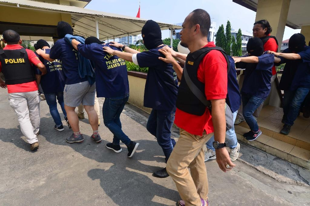 Legal aid groups accused police of refusing to let those arrested get dressed before transferring them to a police station and during subsequent questioning (AFP Photo/FERNANDO)