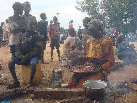 A displaced South Sudanese woman prepares a meal in a camp for internally displaced people in the UNMISS compound in Tomping, Juba, South Sudan