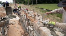 City of Raleigh couldn't destroy this historic stone wall, so it's moving it instead
