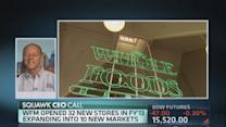 Whole Foods cuts outlook, plans expansion