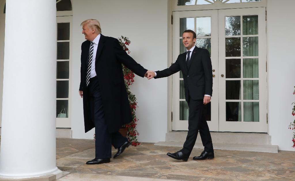 "Since Donald Trump became US president, Emmanuel Macron has attempted to develop a ""special relationship"" with the billionaire tycoon despite widely differing political beliefs and styles (AFP Photo/Ludovic MARIN)"