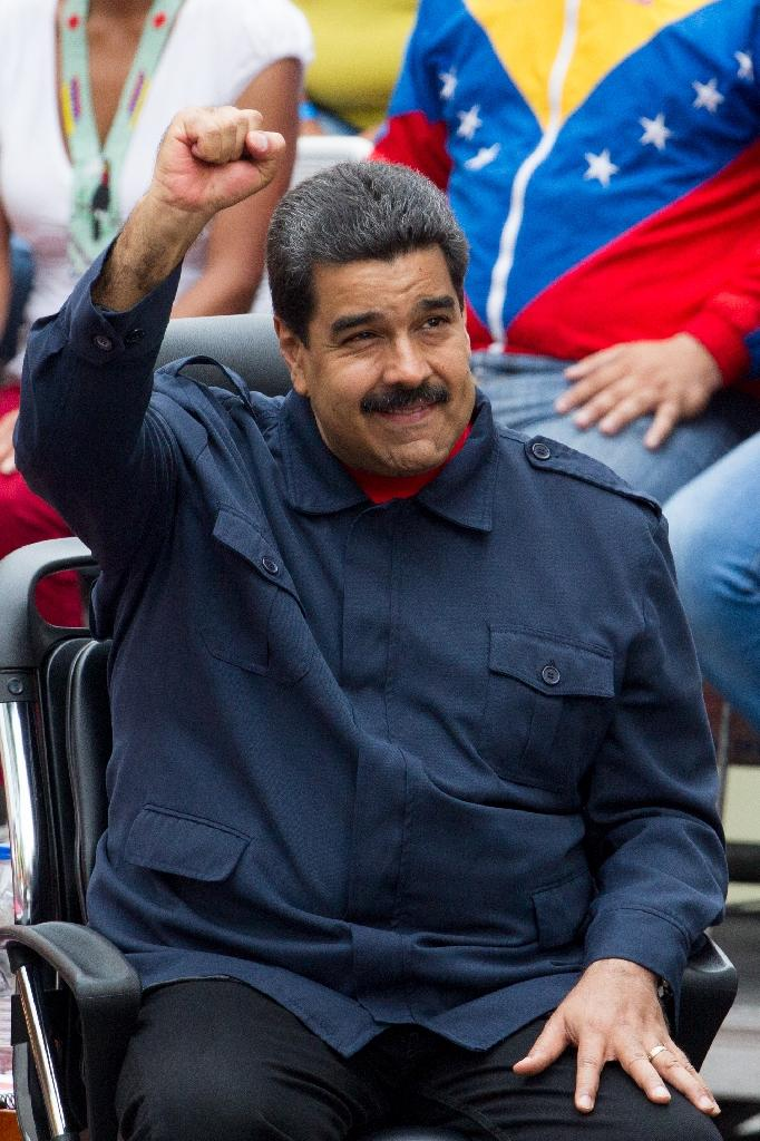 "Venezuelan President Nicolas Maduro has vowed to hold on to power and press on with the socialist ""revolution"" launched by his late predecessor Hugo Chavez (AFP Photo/Federico Parra)"