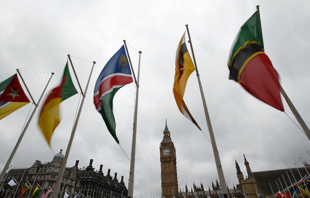 Flags of the Commonwealth nations fly outside the House of Commons in London on March 10, 2013 (AFP Photo/Justin Tallis)
