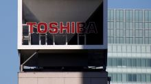 Toshiba reports strong profits, to buy out three listed businesses