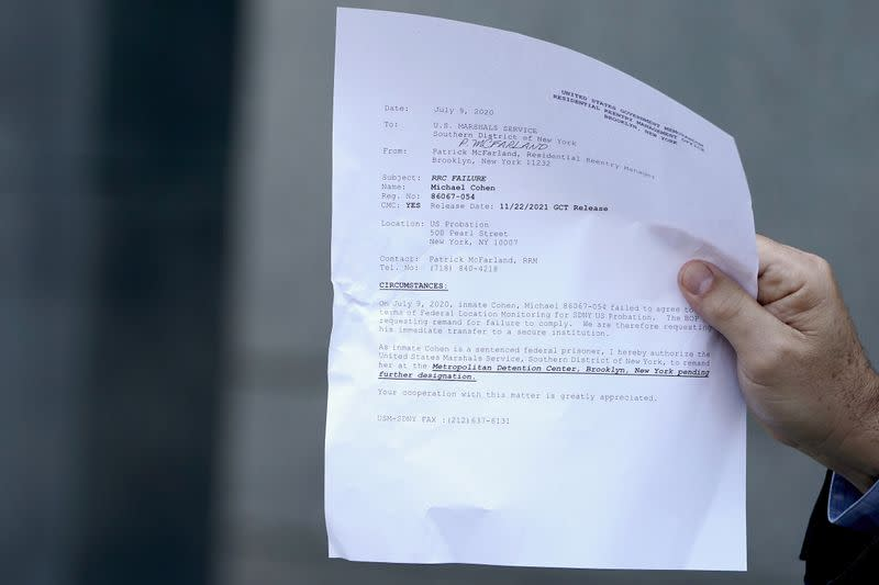 Attorney for Michael Cohen, Jeffrey Levine holds up a document as he tells the media Cohen has been remanded outside Federal Court in the Manhattan Borough of New York City