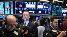 Wall St. edges lower in choppy session