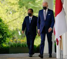 Face masks, social distancing: Biden, Japanese Prime Minister Suga practice diplomacy in COVID era