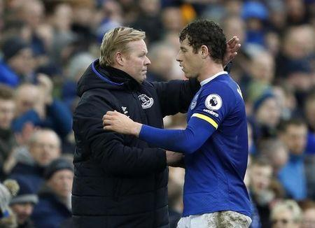 Everton's Ross Barkley walks past manager Ronald Koeman as he is substituted