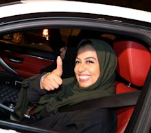 Roses and selfies as women take to the roads in Saudi Arabia for first time