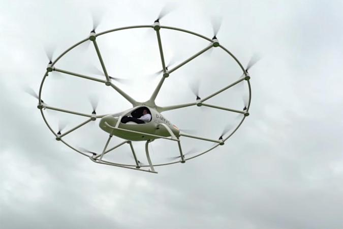 Watch an 18-rotor electric helicopter take its first manned flight