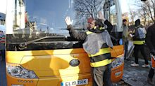 Extinction Rebellion activists dressed as bees swarm Lib Dem bus to demand action on climate change