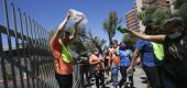 Protesters dump ice in front of the U.S. Immigration and Customs Enforcement building on June 18 in Phoenix. (AP)