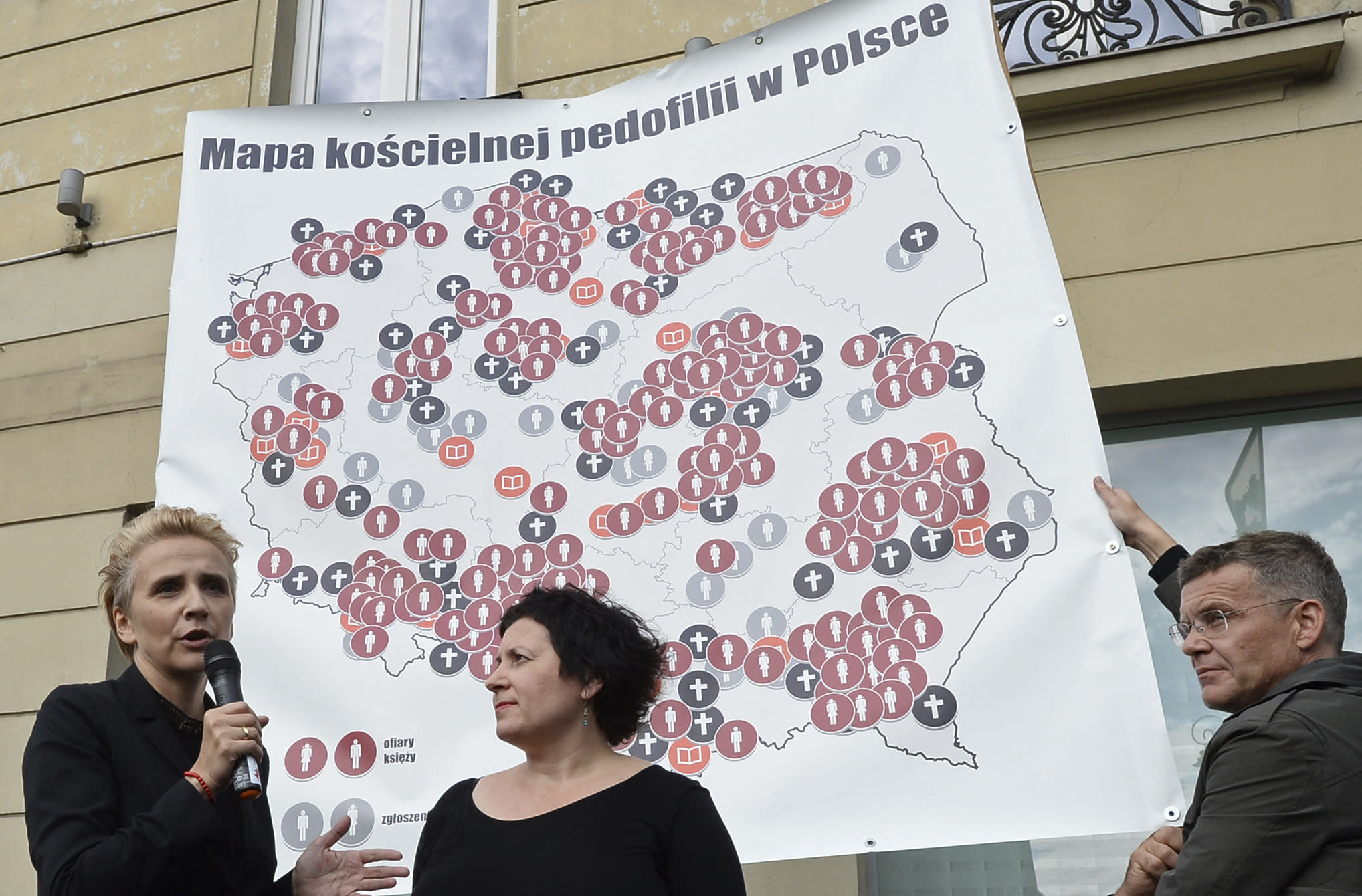 """Protesters present a map of Poland with 255 documented cases of sexual abuse of minors by the country's Catholic priests, during a demonstration in Warsaw, Poland, Sunday, Oct. 7, 2018, demanding the church to stop protecting pedophile priests. The writing on the map reads: """"Map of Church Pedophilia in Poland"""". (AP Photo/Alik Keplicz)"""