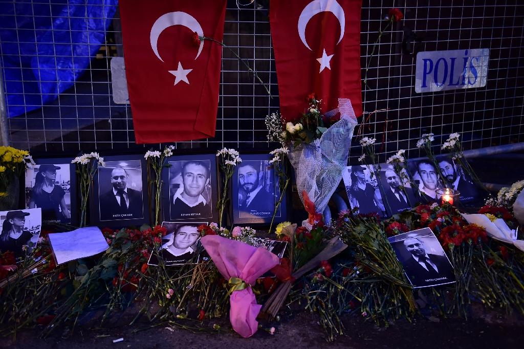 Flowers and portraits of victims of the Reina nightclub attack are laid near the venue in Istanbul as reports emerge claiming the gunman had fought for the Islamic State group in Syria (AFP Photo/YASIN AKGUL)