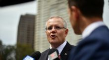 Australia PM rules out early poll after by-election blow