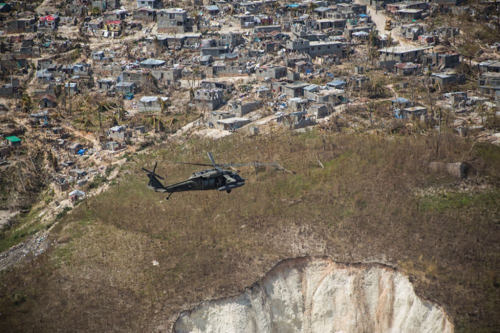 A US Army Black Hawk helicopter deployed in support of Joint Task Force Matthew flies toward Jeremie, Haiti on October 10, 2016