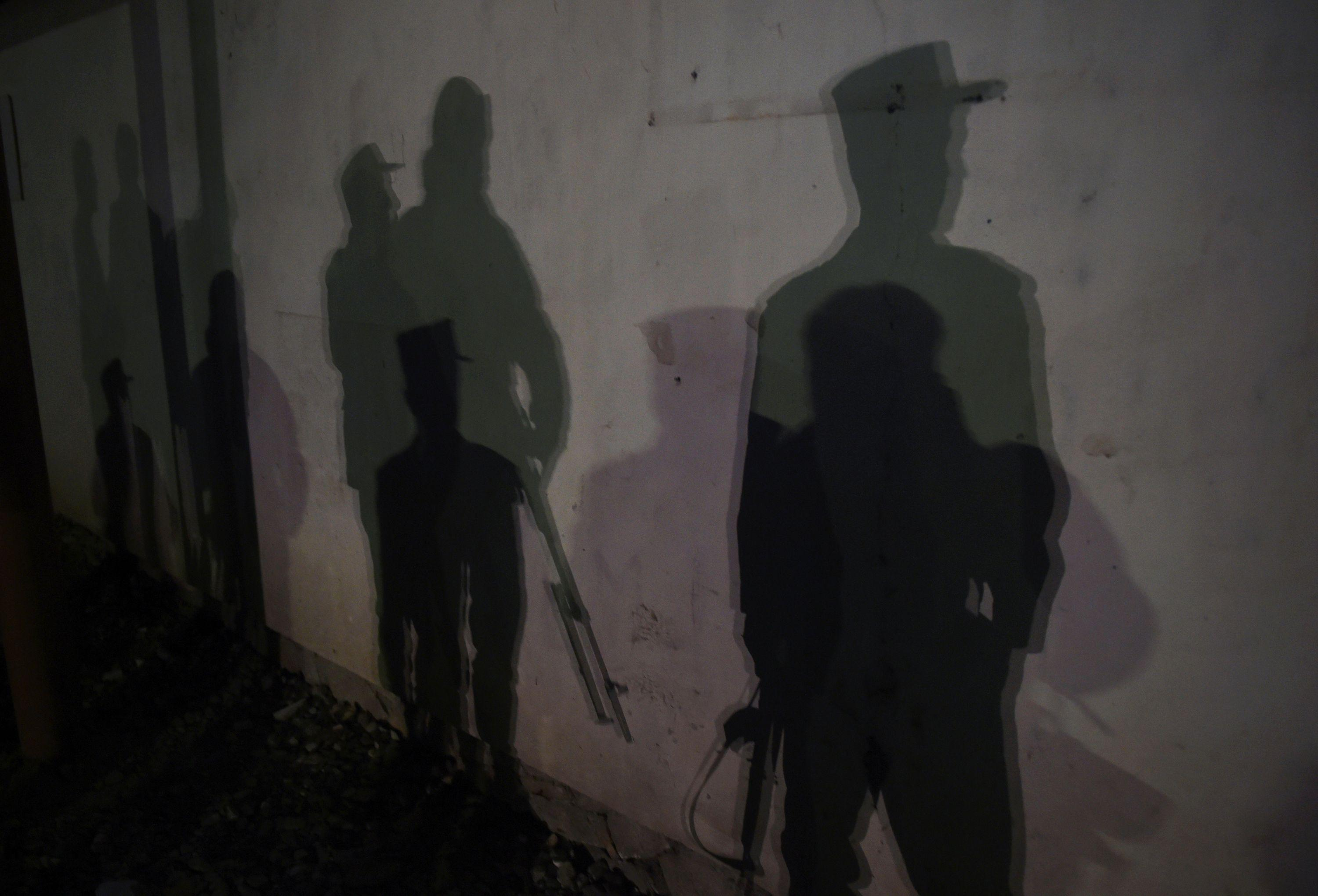 <p>The shadows of Afghan police officers are seen near the site of an attack on the Spanish embassy compound in Kabul on December 11, 2015. Insurgents have launched an attack on a Spanish embassy compound in Kabul on December 11, Afghan officials said, following reports of gunfire and a massive car bomb in the centre of the city. (Photo: Shah Marai/ AFP/Getty Images) </p>