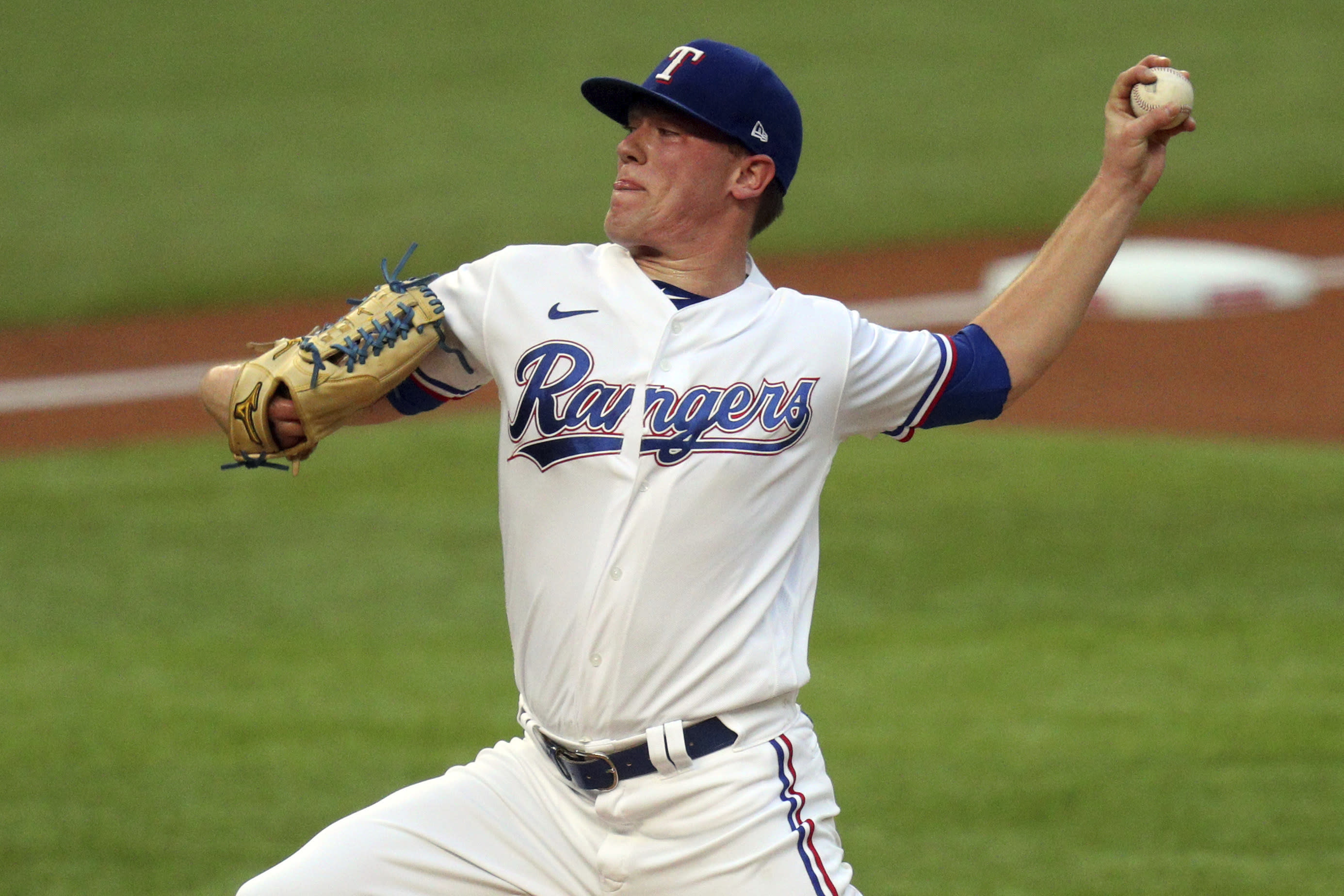Texas Rangers pitcher Kolby Allard works the first inning in the second baseball game of a doubleheader against the Oakland Athletics on Saturday, Sept. 12, 2020, in Arlington, Texas. (AP Photo/Richard W. Rodriguez)