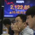 Stocks sink as virus cases jump, forcing states to backtrack