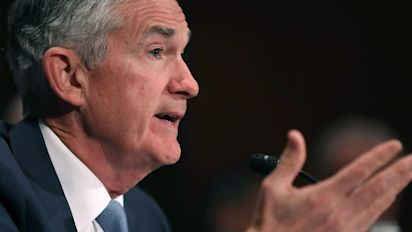 Fed hikes rates, lifts economic and rate outlook